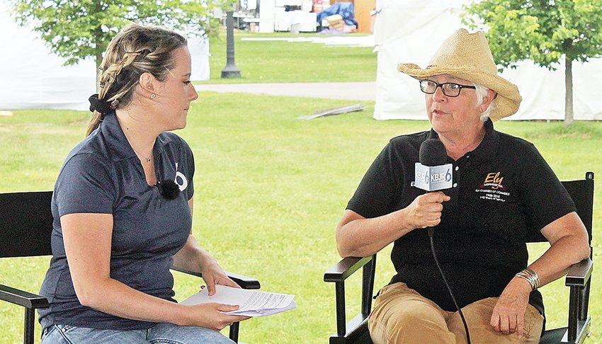 KBJR 6 newscaster Jessie Slater talks with Ely Blueberry / Art Festival organizer Ellen Cashman during a live broadcast from Whiteside Park last Thursday.