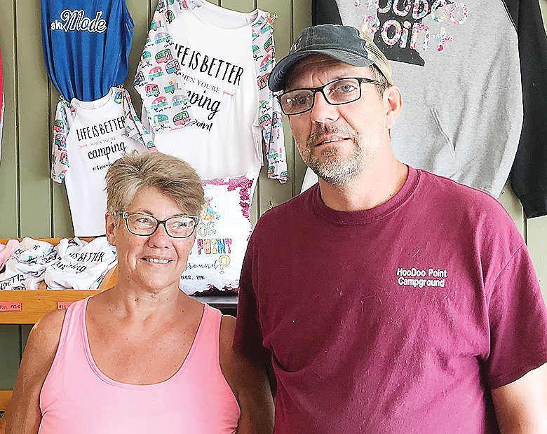 Julie and Randy Pratt take a moment from a busy morning at the campground store to talk about their concerns over the handling of a recent improvement project.
