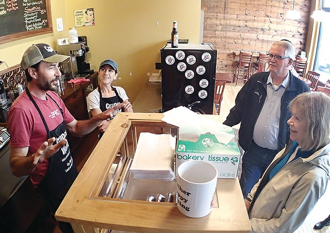 Minnesota's Sen. Tina Smith, along with State Rep. Rob Ecklund, right, visited Tuesday with Brian and Andrea Strom at the Crapola World Headquarters in Ely.