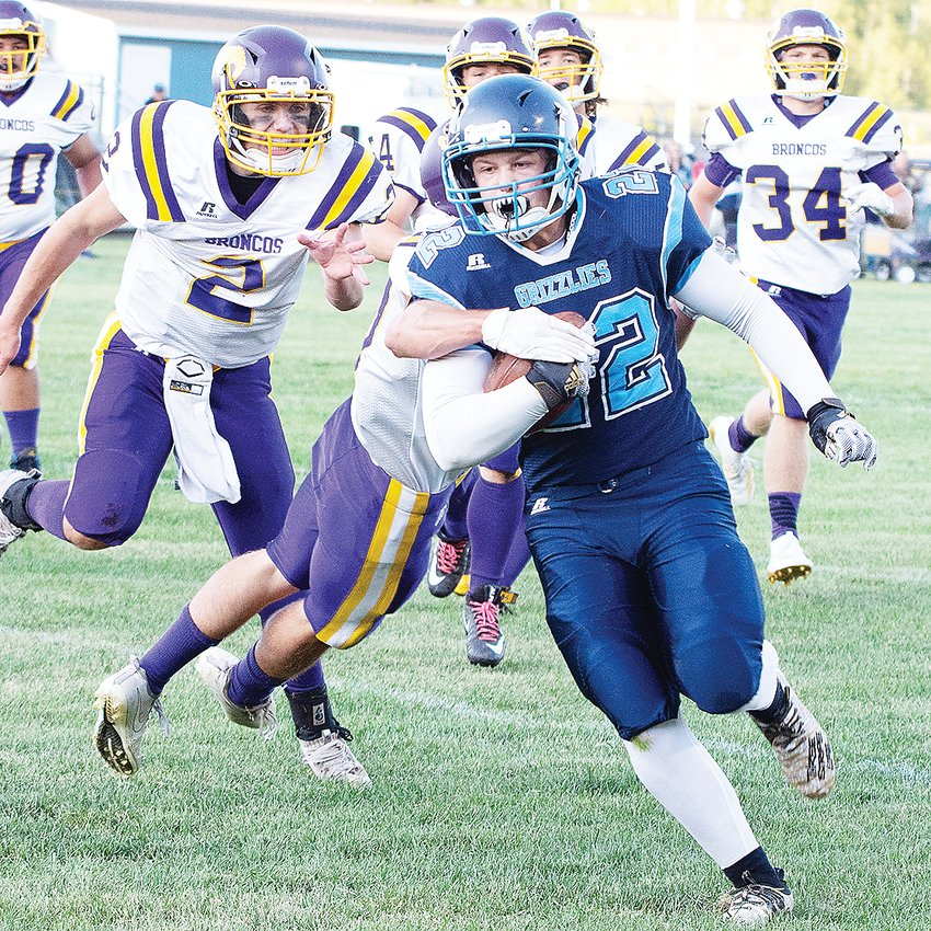Sophomore runningback TJ Chiabotti slips a tackler on his way to the end zone during the Grizzlies' opening drive.