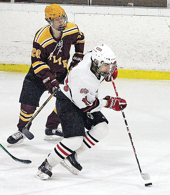 Ely's Jimmy Zupancich advances the puck during last Saturday's home game against Bagley-Fosston.
