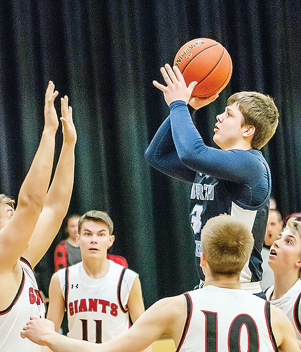 TJ Chiabotti goes up for a jumper in the first half against Mesabi East on Friday.