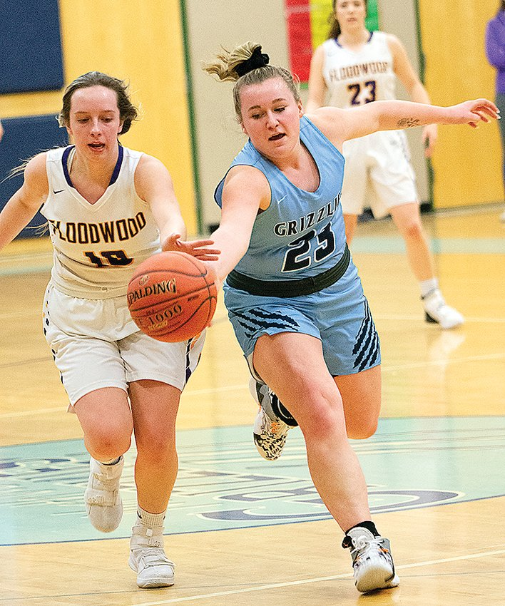 North Woods senior Kennedy Wardas tries to out-hustle a Floodwood player for a loose ball.
