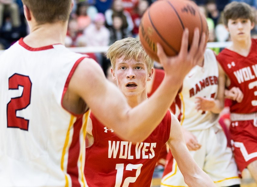 Emmett Faltesek, front, bears down on defense for the Timberwolves while Joey Bianco angles for position in the background during Saturday action against Mountain Iron-Buhl.