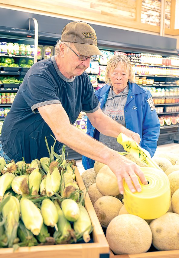 Jim and Sandi Boutto of Cook check out the fresh produce section of the new Cook Zup's Market.