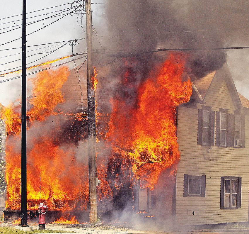 Ely firefighters battled gusty winds last Thurday as they attempted to douse a house fire near the city's downtown.