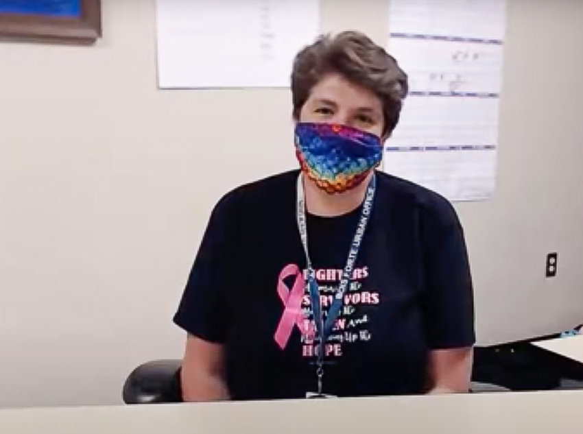 Bois Forte Band Community Health Nurse Teri Morrison wears a mask while conducting a teleconference question and answer session on issues related to COVID-19.
