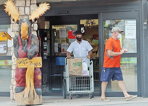 Shoppers and workers at Zup's Market in Ely were properly masked up on Saturday, the first day of   the statewide   mandate.