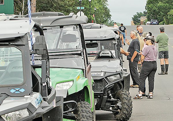 ATV enthusiasts gathered on the streets of Ely last month for a rally and ride to Babbitt.  Plans for a state ATV convention here, set for   September, will be adjusted to reduce the risk of spread of COVID-19.