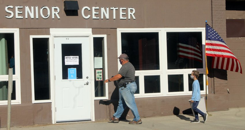 Mike Banovetz enters the Ely Senior Center Tuesday morning to vote on a bonding referendum to help fund a school building project.