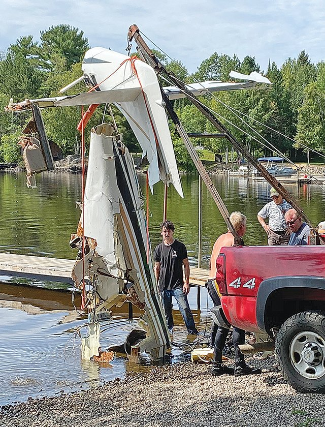 The wreckage of an airplane that crashed into White Iron Lake last week was brought ashore late Tuesday.