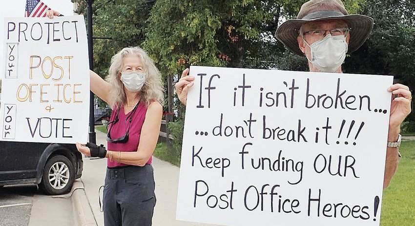 Supporters of the United States Postal Service rally outside of the Cook Post Office last Saturday.