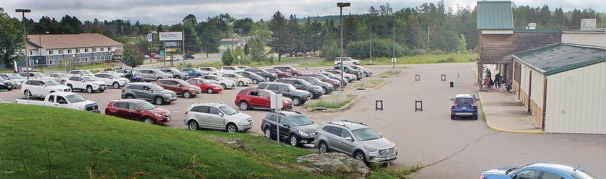 Dozens of cars nearly fill the Shopko parking lot for last Sunday's sermon by Pastor Eric Thiele.
