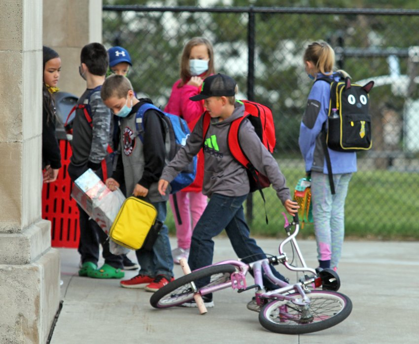 Students enter Washington Elementary on the first day of school