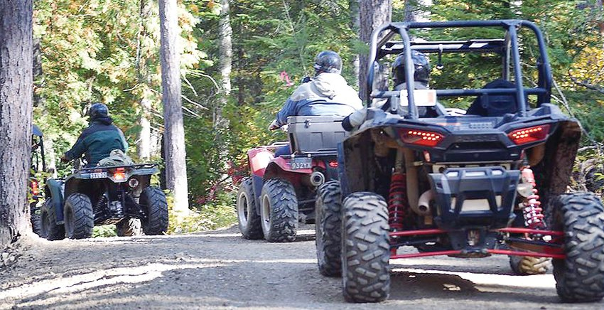 Riders make their way down an ATV trail during last weekend's ATVAM ride and rally event held in the area.