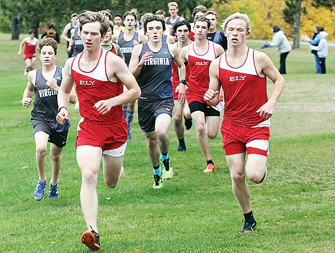 Jasper Johnston and Emmett Faltesek run ahead of a large pack at the Ely home cross country meet.