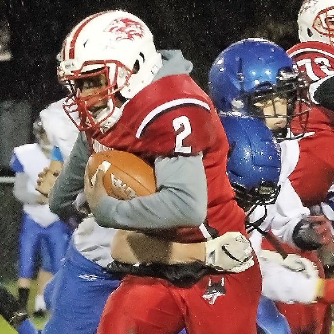 Ely sophomore halfback Jason Kerntz proved hard to handle   for Cook County defenders as he led Ely rushers with 132 yards under cold and wet conditions.