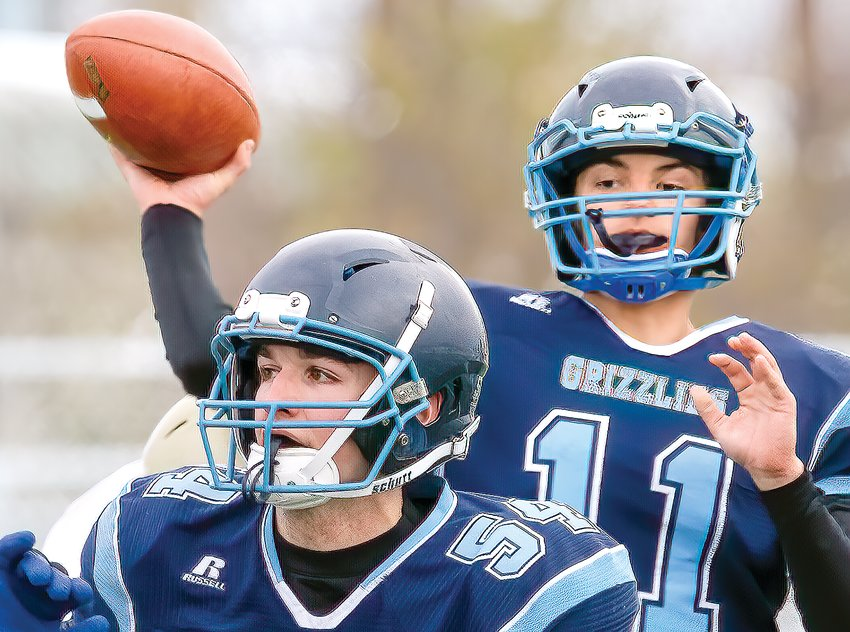 Grizzlies QB Ty Fabish looks downfiled for a receiver as Cole Thiel provides protection against Braham.