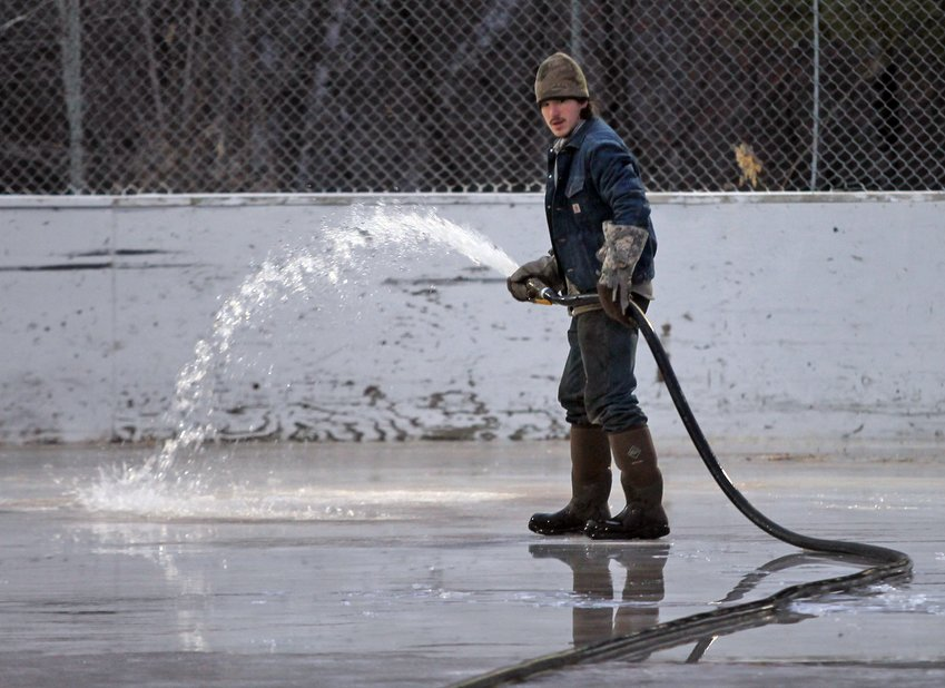Dylan Cain (pictured) and Charles Greenburg have been working this month on flooding the ice rink at the Ely Recreation Center.