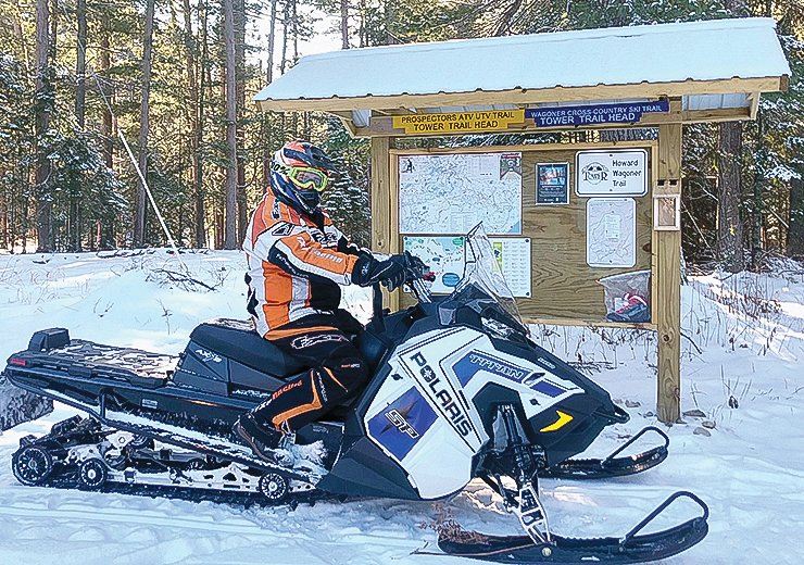 Terry Wagoner is decked out as he gets ready to groom the Howard Wagoner ski trails, near Tower, with the trail club's new utility-grade snowmobile.