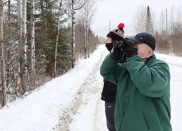Wally Refsdal, of Cook eyes a bird with   binoculars.  Wally was out with his grandson Jake Panichi during the Cook area bird count.