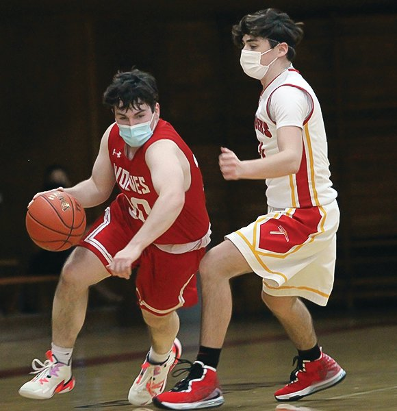 Ely's Will Davies drives to the bucket during last Friday's game against Mt. Iron-Buhl.