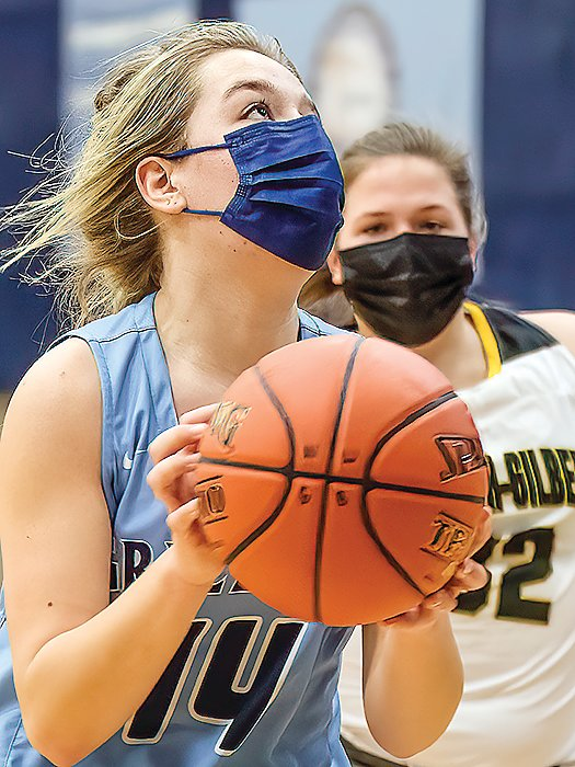 Left: Madi Dantes eyes the basket as she looks to shoot with an Eveleth-  Gilbert defender coming   up from behind.