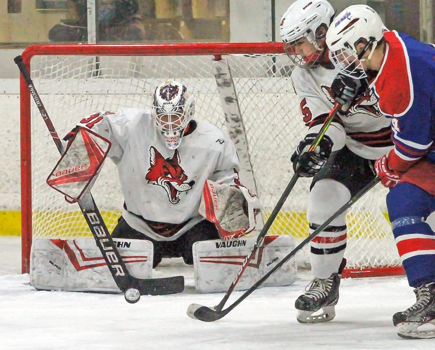 Ely goalie Ben Cavalier blocks a shot during recent action against the Moose Lake Area Rebels.  The   Rebels peppered Cavalier with 29 shots on goal.