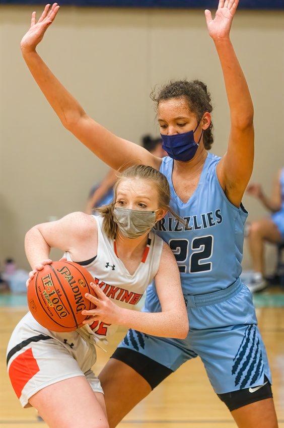 North Woods' Hannah Kinsey puts a halt to a Littlefork-Big Falls ball handler's drive.