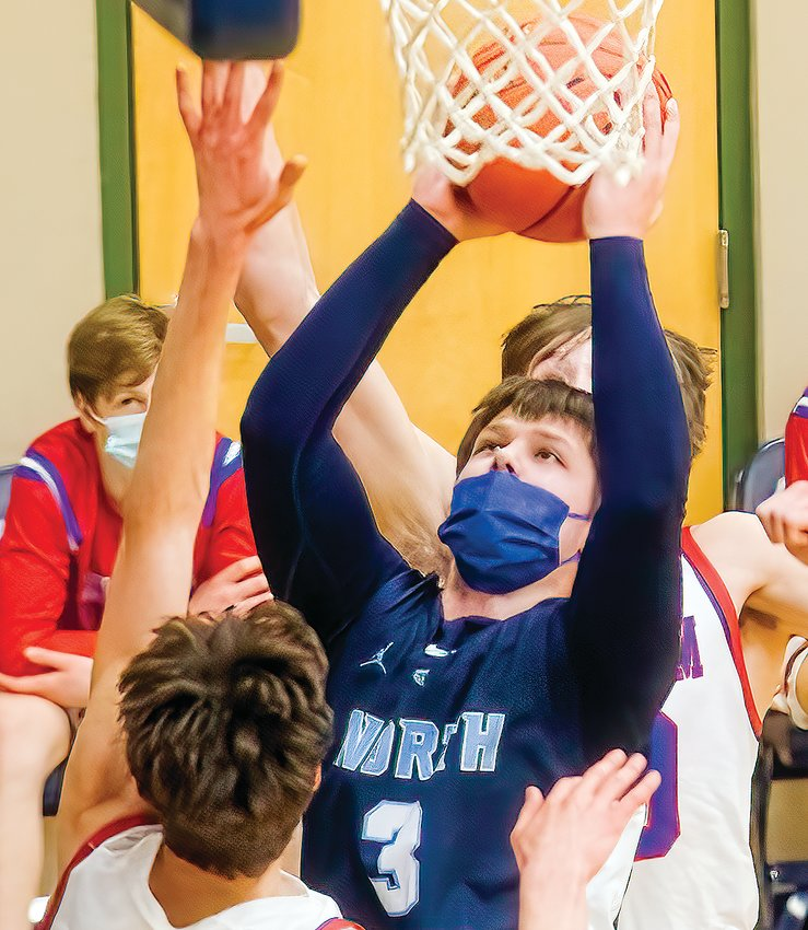 The Grizzlies' T.J. Chiabotti goes up for a jump shot in traffic during their recent contest with Chisholm.
