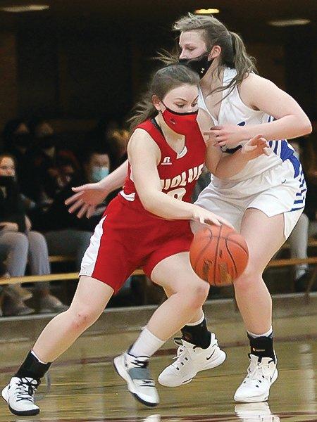 Ely's Sarah Visser drives around a defender.