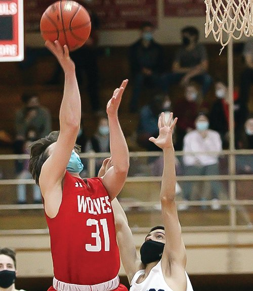Ely's Harry Simons takes off for a layup against Cook County.