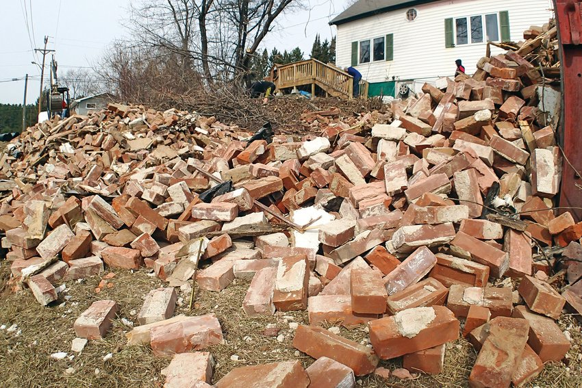 Piles of red clay bricks were all that remained after the former Winton Jailhouse was demolished last week to make way for a storage building for the new owners of the property, who purchased the site from the city of Winton last year.
