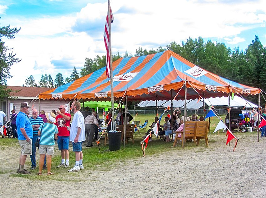 Fair attendees gather under and around a tent at a past Bear River Fair in an image that may be one of the last ever taken of the fair.