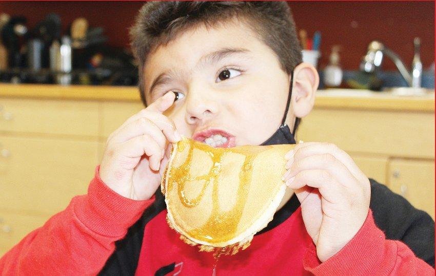Vermilion branch Boys and Girls Club member Reese enjoys a pancake.