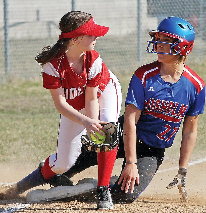 Ely's Bella Davis makes the catch at third base, but just a moment too late to knock out Chisholm's baserunner.