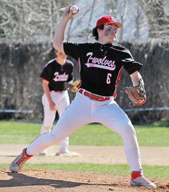 Ely senior pitcher Will Davies winds to deliver during Tuesday's match-up with Mesabi East.