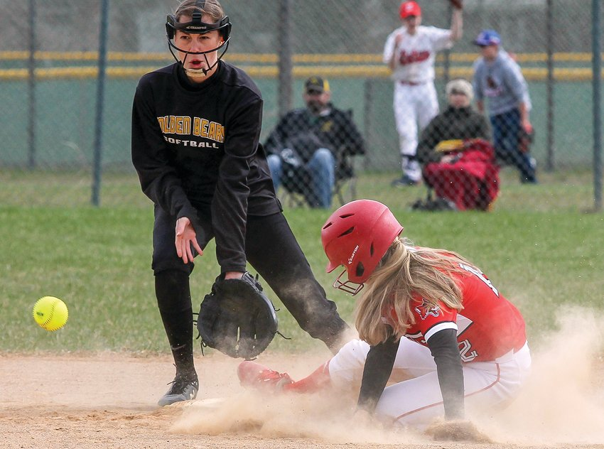 Ely senior Sydni Richards slides safe into   second base in a steal attempt last Thursday against   Eveleth-Gilbert. Ely went on to lose to the Golden Bears, but they rebounded with back-to-back wins later in the week.