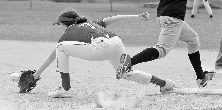You make the call: Safe or Out?  Ely's Madeline Kallberg reaches out as the ball touches her glove just as the baserunner's foot is poised to hit first base. Which goes to show the umpire's job is never easy.