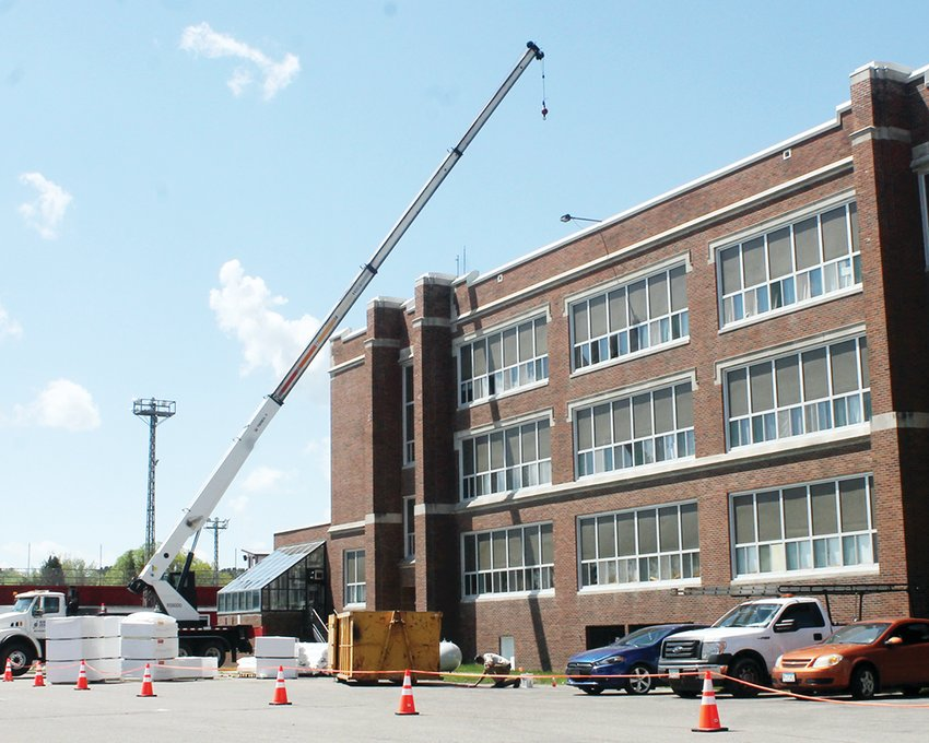 A new roof is being installed this week on the Memorial High School building.