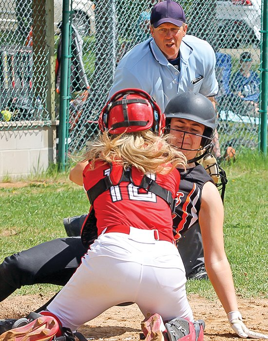 You're out! Umpire  D.J. Janeksela calls a Cherry runner out at home as Ely catcher Sydni Richards puts on the timely tag.