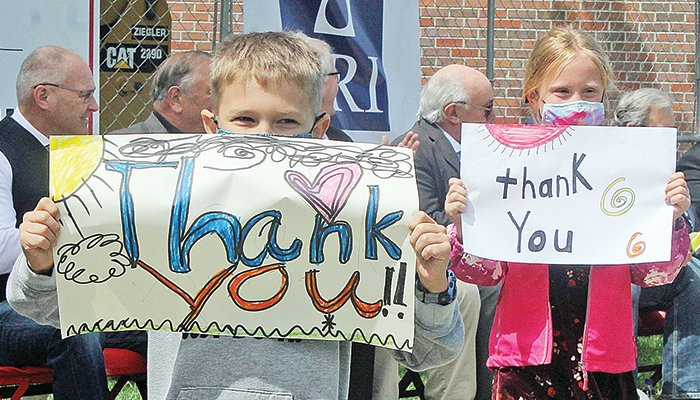 """Washington Elementary students carried hand- made signs in a """"thank you"""" parade last week at the school district's facility renovation groundbreaking ceremony."""