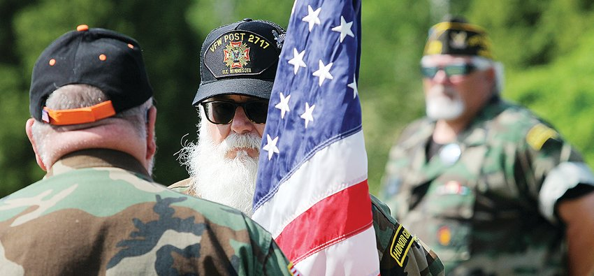 Ely Honor Guard commander Mike Pope and other veterans took part in the Memorial Day Service at the Ely Cemetery.