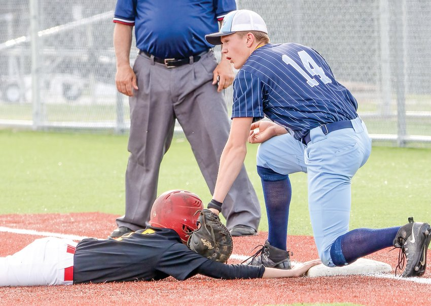 Grizzlies first baseman Ty Leinonen doesn't get the call on a pickoff play.