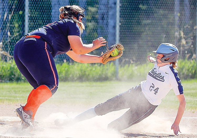 North Woods' Addy Hartway slides under a tag in the Grizzlies' 6-0 win over Nashwauk-Keewatin on May 28.