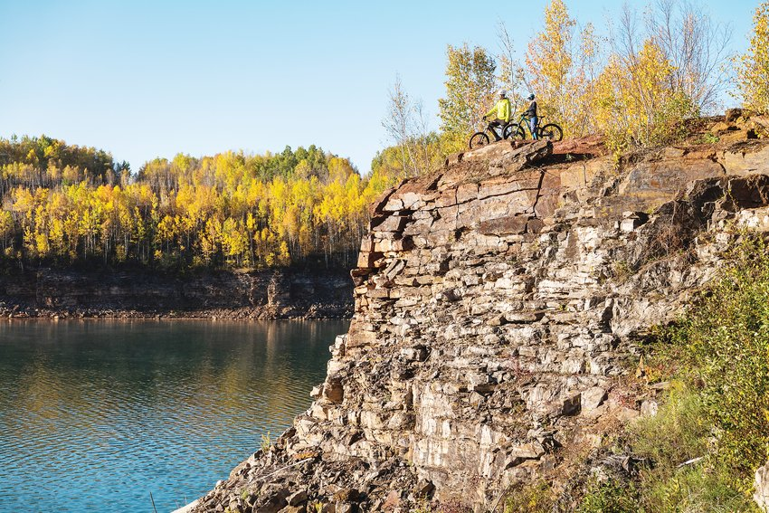 Mountain bikers enjoy a scenic view from Redhead's Pit Plunge Trail.