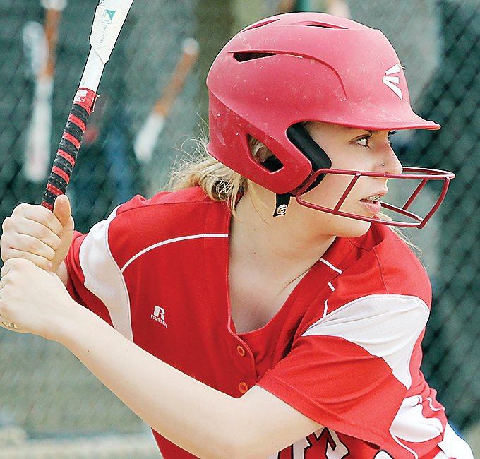 Sydni Richards, Ely's lone senior this season, eyes the ball from the plate.