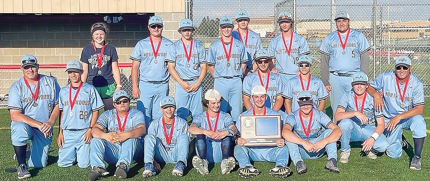 The Grizzlies baseball team poses with their Section 7A runners-up trophy, marking the end of their most successful season to date.  Pictured: (front row, l-r) Ass't Coach RJ Kruse, players Alex Burckhardt, AJ Zakrajshek, Talen Jarshaw, Andrew Zika, Cole Thiel, Zach Cheney, Ben Kruse, Head Coach Jeff Smerud; middle row: Chris Chaulklin and Logan Nurmi; back row: Manager Abby Koch, players Kohen Briggs, Austin Sokoloski, Louis Panichi, Ty Leinonen, Jake Panichi, and Caleb Uchal.