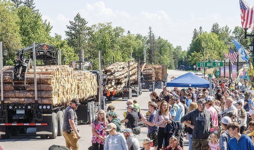 Logging trucks brought up the rear of a 40-minute Timber Days parade on Sunday, passing by a large and enthusiastic crowd.