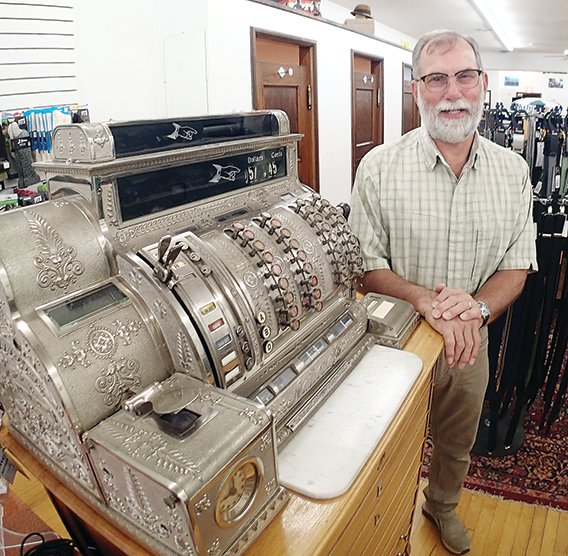 John Mills still uses a vintage cash register in the J.D. Mills Company clothing store on Sheridan Steet in Ely.